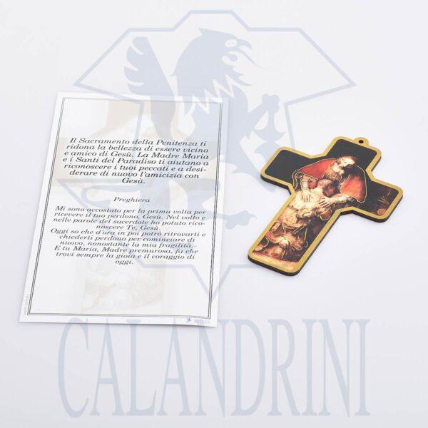 Penitencia cruzada con borde de oro y pergamino con oración.